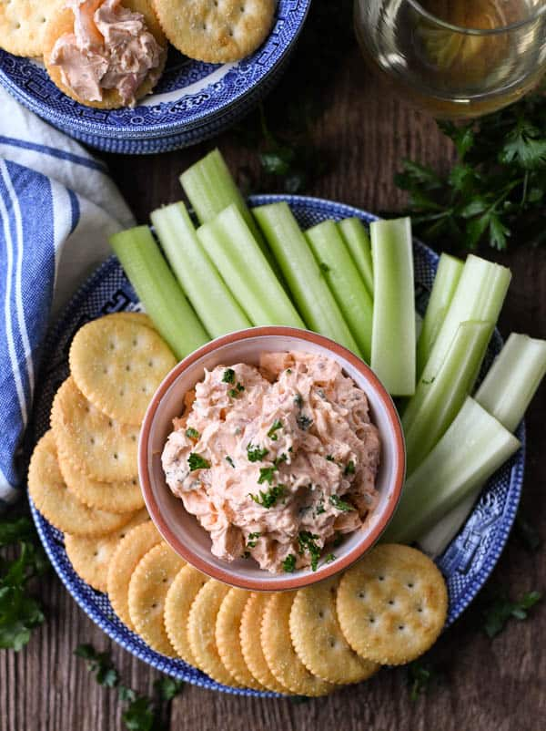 Overhead shot of shrimp dip on a plate with celery sticks and crackers
