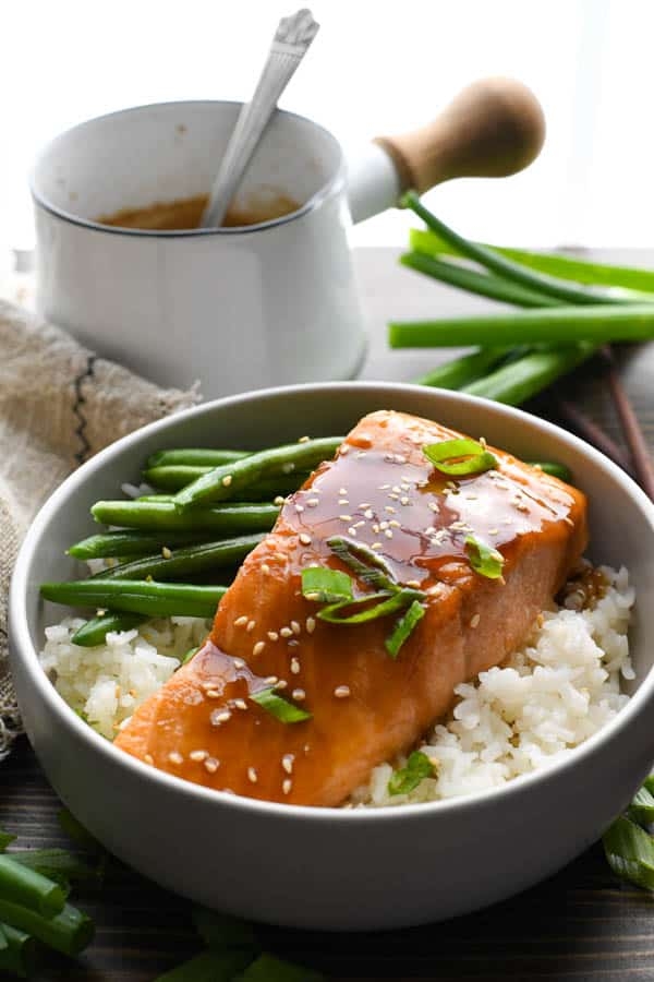 Front shot of easy baked teriyaki salmon recipe served over rice