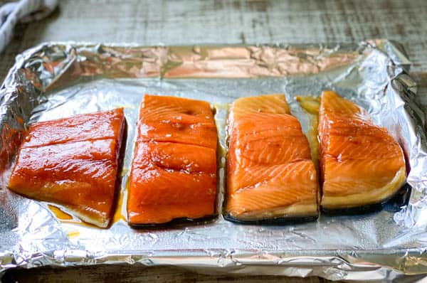 Process shot showing how to bake teriyaki salmon in the oven