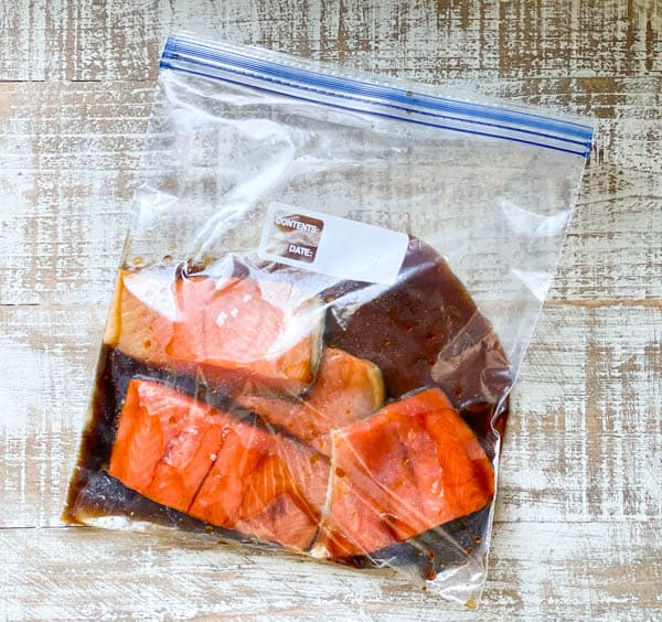Marinating salmon in teriyaki sauce