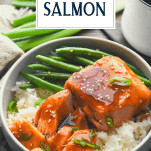 Close up side shot of a piece of baked teriyaki salmon with a text title overlay