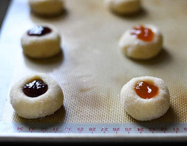 Process shot showing how to make jam thumbprint cookies