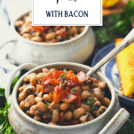Side shot of two bowls of black eyed peas with bacon and text title overlay