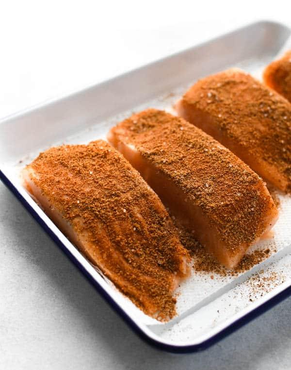 Process shot showing how to make blackened salmon