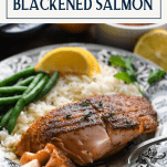 Front shot of a fork eating a piece of blackened salmon with text title box at top