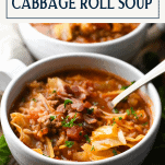 Side shot of a bowl of cabbage roll soup with text title box at top