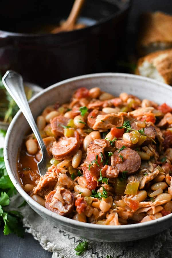 Close up side shot of a bowl of chicken cassoulet