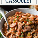 Close up side shot of a bowl of easy chicken cassoulet with text title box at top