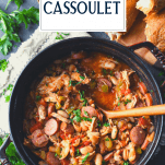Overhead shot of a pot of chicken cassoulet with text title overlay