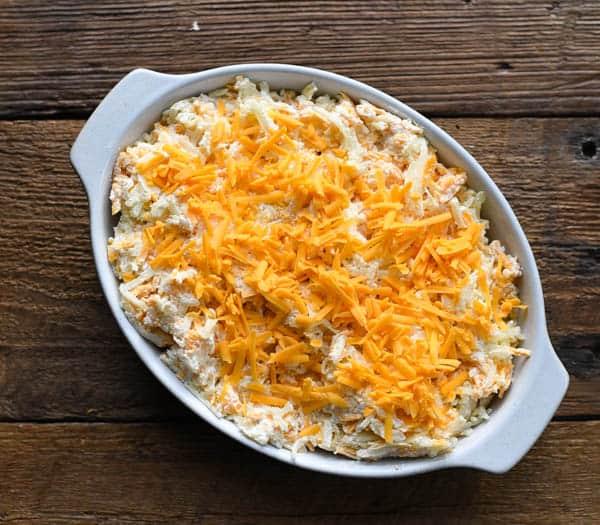 Process shot showing how to make cheesy potato casserole