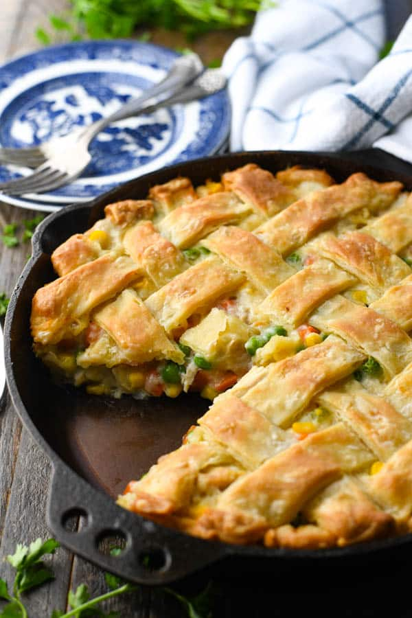 Side shot of a creamy chicken pot pie recipe with a lattice top crust