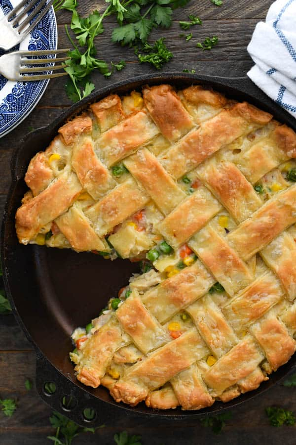 Close overhead shot of the best chicken pot pie recipe baked in a cast iron skillet with a slice cut out