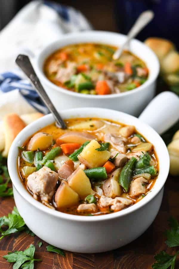 An easy chicken stew recipe served in two white bowls