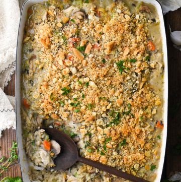 Overhead shot of chicken breast and wild rice casserole with Ritz crackers on top
