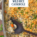 Overhead shot of a chicken wild rice and vegetable casserole with text title overlay