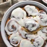 Close overhead shot of a tray of homemade cinnamon rolls