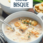 Bowl of shrimp and crab bisque with text title overlay