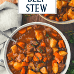 Overhead shot of Dutch Oven beef stew with text title overlay