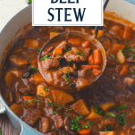 Ladle in a pot of dutch oven beef stew with text title overlay