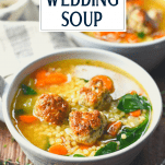 Close up shot of bowl of Italian Wedding Soup with text title overlay