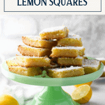 Front shot of a green cake stand full of creamy lemon squares with text title box at top