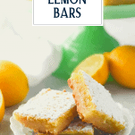 Three lemon bars on a small plate with text title overlay