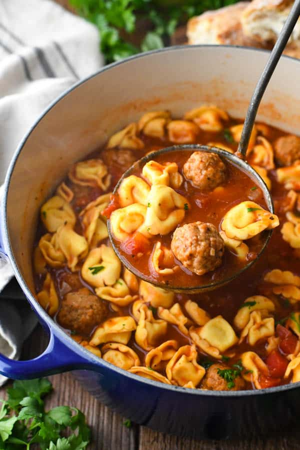 Close up side shot of a ladle in a pot of Italian mini Meatball Soup