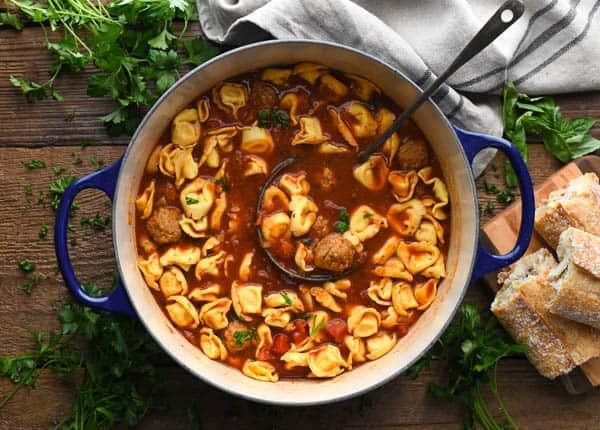 Overhead horizontal shot of a pot of mini meatball soup