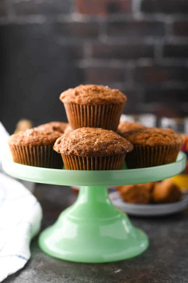 Stack of easy morning glory muffins on a serving tray.