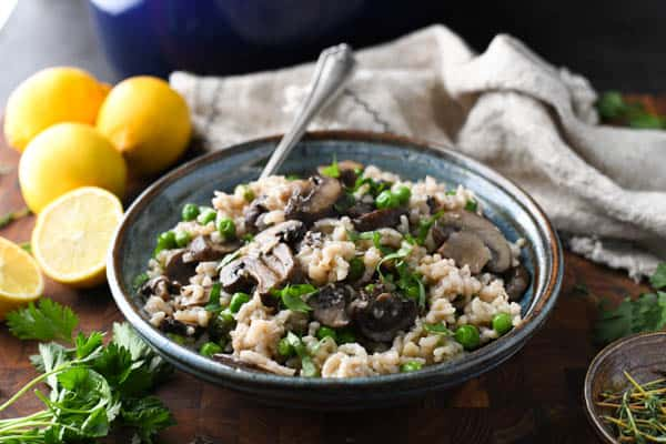 Horizontal shot of a bowl of the best mushroom parmesan risotto with peas