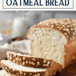 Front shot of sliced loaf of farmhouse oatmeal bread with text title box at top