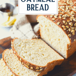 Side shot of a sliced loaf of the best oatmeal bread recipe with text title overlay