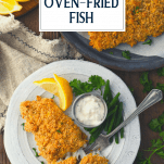 Overhead shot of crunchy oven fried fish on a plate with text title overlay