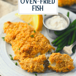 Crispy oven fried fish on a white plate with text title overlay