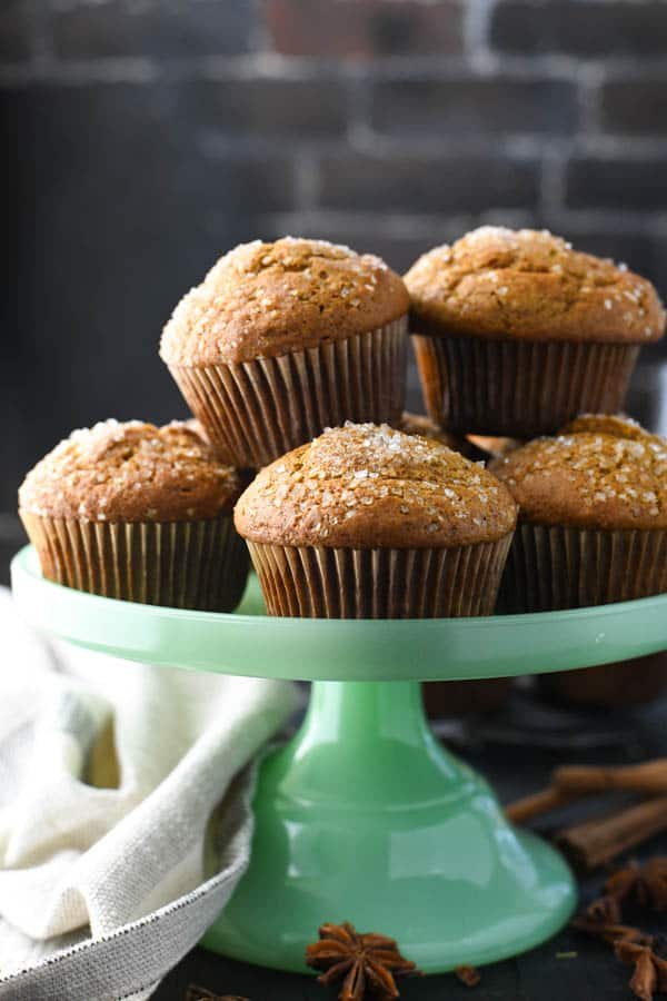 Close up front shot of applesauce pumpkin muffins on a serving tray