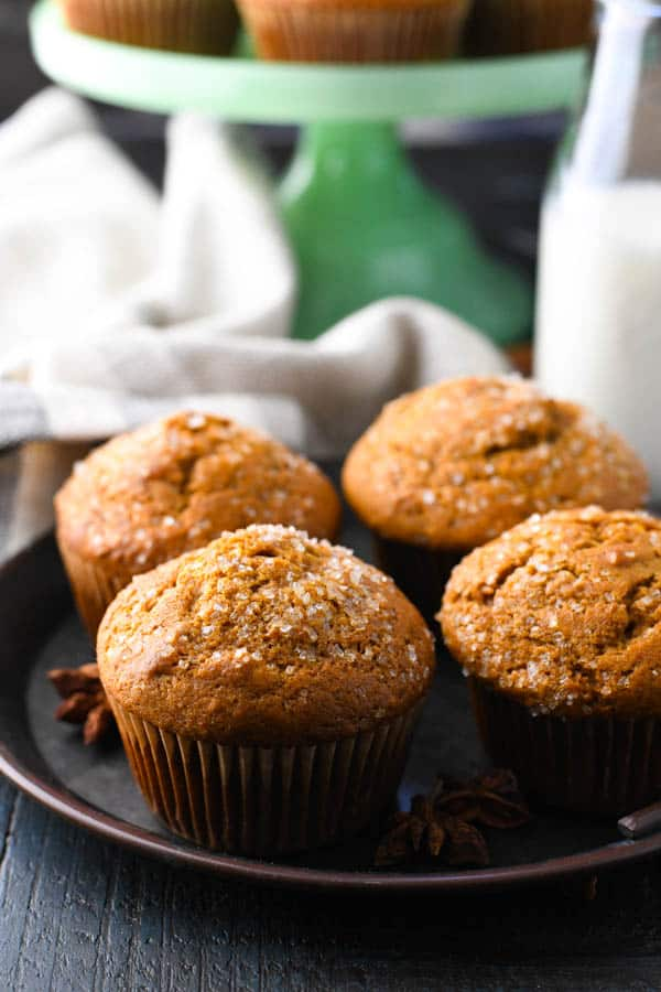 Tray of easy pumpkin muffins with glass of milk in the background