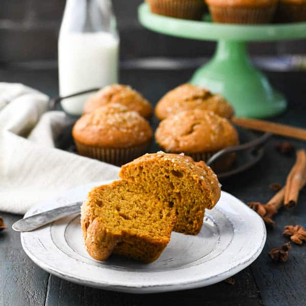 Healthy applesauce muffins cut in half on a plate