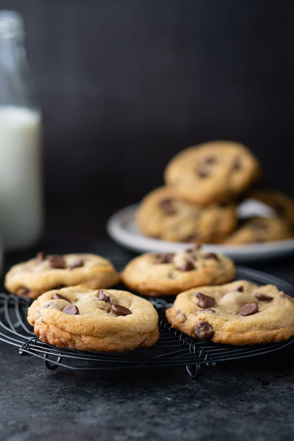 Chewy chocolate chip cookies on a wire cooling rack
