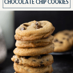 Stack of chewy chocolate chip cookies with text title box at top