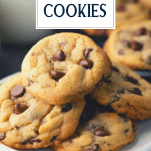 Close up shot of a plate of chewy chocolate chip cookies with text title overlay