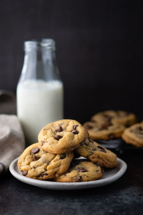 Side shot of a plate of homemade chocolate chip cookies