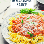 Plate of spaghetti bolognese with text title overlay