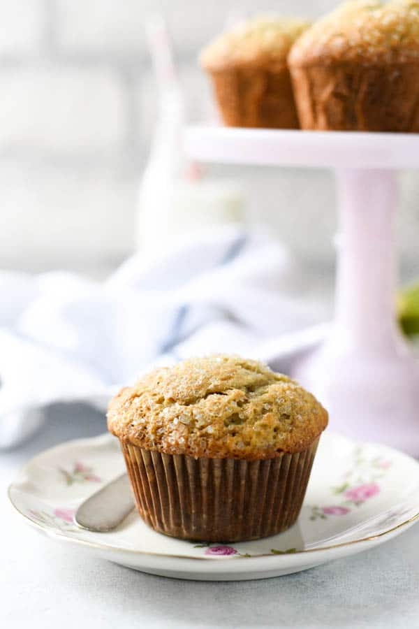 Homemade easy banana muffin recipe on a white table in front of a white background