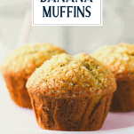 Close up side shot of moist banana muffins with text title overlay