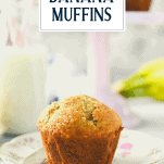 Side shot of banana muffins on a plate with text title overlay