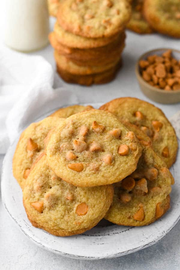 A white plate of the softest ever butterscotch cookies