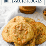 A plate of butterscotch chip cookies on a white table with text title box at the top