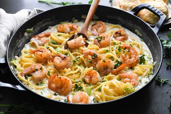 Process shot showing how to make cajun shrimp pasta