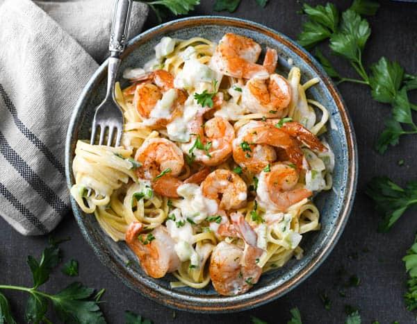 Horizontal overhead shot of a bowl of creamy Cajun shrimp pasta Alfredo.