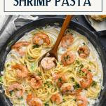 Skillet of Cajun Shrimp Pasta with text title box at top